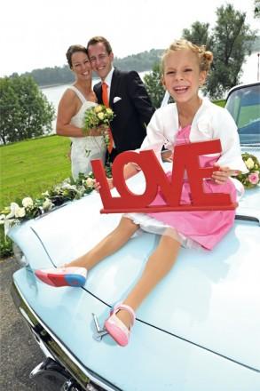 Hochzeitsfotograf Foto Wolff: Brautpaar mit Kind